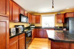 Kitchen room with black granite tops Stock Images