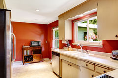 Kitchen room with bright red walls Stock Images