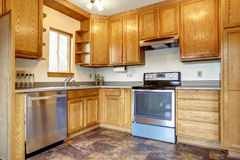 Kitchen room interior with brown tile floor Stock Photography