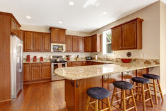 Kitchen room interior with island and countertop stools Stock Photos