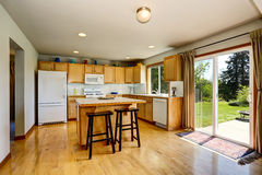 Kitchen room interior with light brown cabinets and island. Stock Photos
