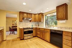 KItchen room interior with stainless steel and hardwood floor. Stock Photos