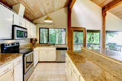 Kitchen room in log cabin house with walkout deck Royalty Free Stock Photo