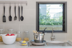 Kitchen room with  utensil and sink on counter Royalty Free Stock Image