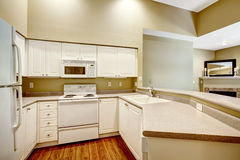 Kitchen room with white cabinets and appliances Royalty Free Stock Photos