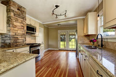 Kitchen room with white cabinets, stainless steel and hardwood floor Stock Photography
