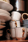 Kitchen's junk. Cups, plates and other junk on the kitchen shelf Stock Photos