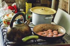 Kitchen, sausage, skillet royalty free stock photography