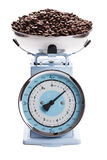 Kitchen scale with coffee beans Royalty Free Stock Photo