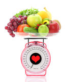 Kitchen scale with fruits and vegetables Stock Photos