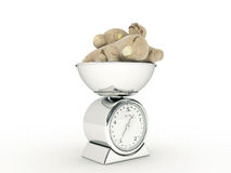 Kitchen scale with giant ginger Royalty Free Stock Photo