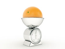 Kitchen scale with giant orange Royalty Free Stock Images