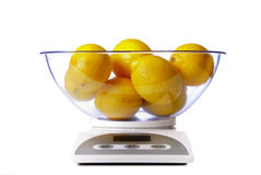 Kitchen scale with lemons Royalty Free Stock Image