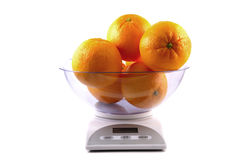 Kitchen scale with oranges Stock Photography