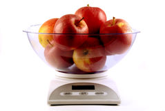 Kitchen scale with red apples Royalty Free Stock Images