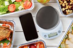 Kitchen scale and salad stock images