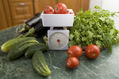 Kitchen scale and vegetables Royalty Free Stock Images