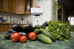 Kitchen scale and vegetables Stock Photography