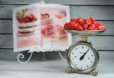 Kitchen Scale weighing strawberries Stock Image