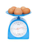 Kitchen scales and eggs. Isolated on white background (with clipping path Stock Photo