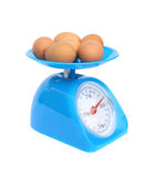 Kitchen scales and eggs. On white background (with clipping path Stock Image