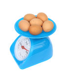 Kitchen scales and eggs. On white background (with clipping path Stock Photography