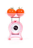 Kitchen Scales with fresh tomatoes Royalty Free Stock Image
