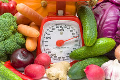 Kitchen scales and fresh vegetables Stock Photos