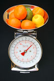 Kitchen scales with fruit Royalty Free Stock Image