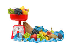 Kitchen scales, fruits and measuring tape isolated on white back Royalty Free Stock Photo