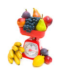 Kitchen scales and fruits  on white background close-up. Stock Photos