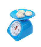 Kitchen scales and garlic isolated on white background Stock Image