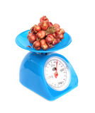 Kitchen scales and onions Stock Photo