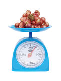 Kitchen scales and onions Royalty Free Stock Photography