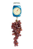 Kitchen scales and red grapes. Royalty Free Stock Photography