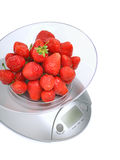 Kitchen scales with ripe strawberries Royalty Free Stock Photos