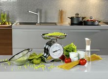 Kitchen scales on the table Stock Photos
