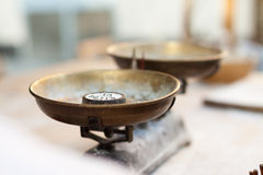 Kitchen scales on a table. Kitchen scales with weights on the table stock photography