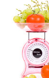 Kitchen Scales With Fresh Tomatoes And Grapes Royalty Free Stock Images
