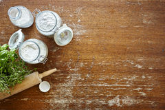 Kitchen scene baking jars with flour wooden table Royalty Free Stock Photos