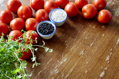 Kitchen scene with tomatoes and herbs Stock Image