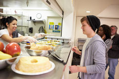 Kitchen Serving Food In Homeless Shelter Royalty Free Stock Photo