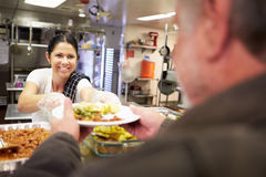 Free Kitchen Serving Food In Homeless Shelter Stock Photos - 39223013