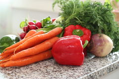 Kitchen setup. Kitchen composition with fresh vegetables on work table Royalty Free Stock Photography