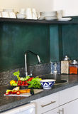 Kitchen setup. Kitchen composition with fresh vegetables on work table royalty free stock image
