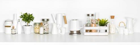 Kitchen shelf full of various utensils isolated on white background.  Royalty Free Stock Photography