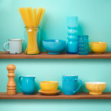 Kitchen shelf storage with tableware. Over retro background royalty free stock images