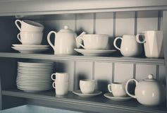 Kitchen shelves with white rustic. Dinnerware Stock Photo