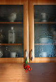 Kitchen showcase with chili. Vitreous kitchen showcase with chili Royalty Free Stock Images