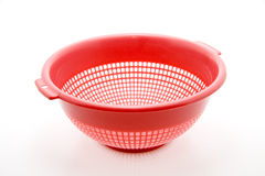 Kitchen sieve. Red plastic kitchen sieve exempted Stock Photography
